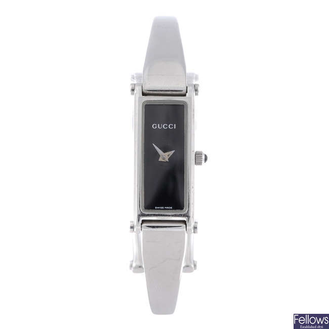 GUCCI - a lady's stainless steel 1500L bangle watch.