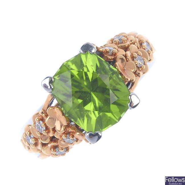 A peridot and diamond dress ring.