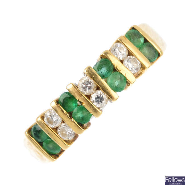An 18ct gold diamond and emerald dress ring.