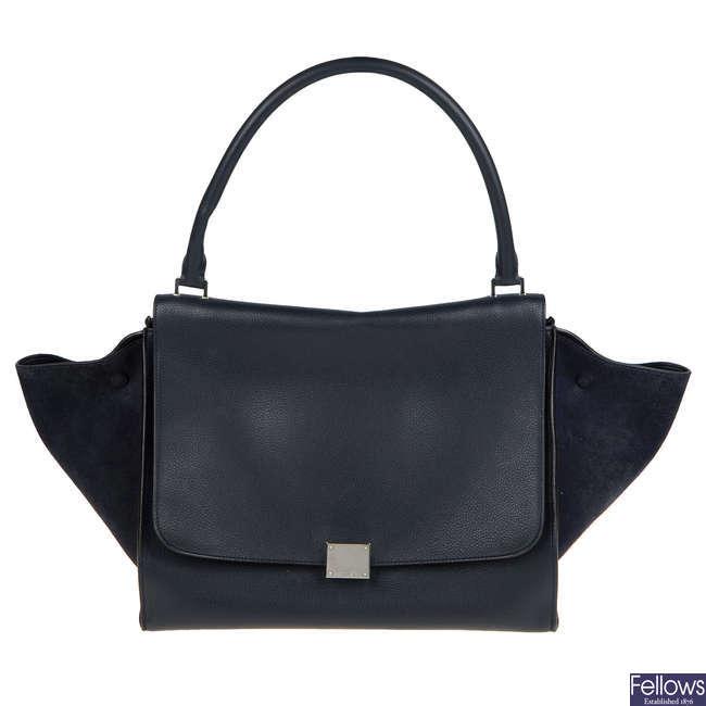 CÉLINE - a navy blue Trapeze handbag.