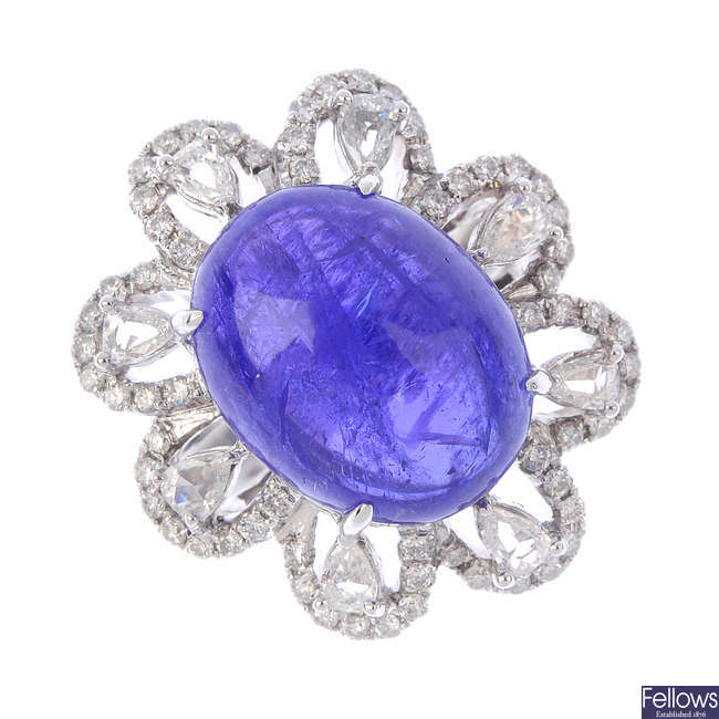 A tanzanite and diamond floral dress ring.