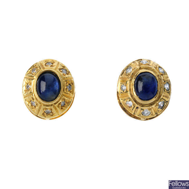 A pair of sapphire and diamond earrings.