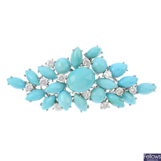 A turquoise and diamond brooch.