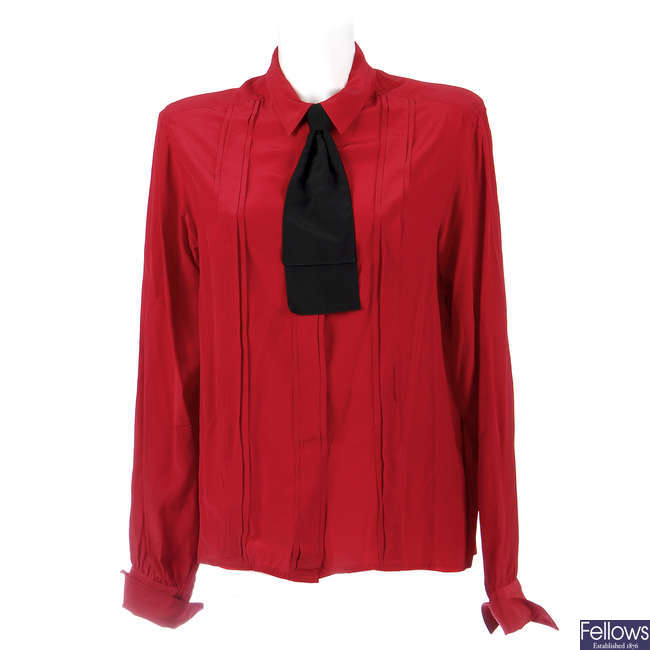 CHANEL - a red silk blouse.