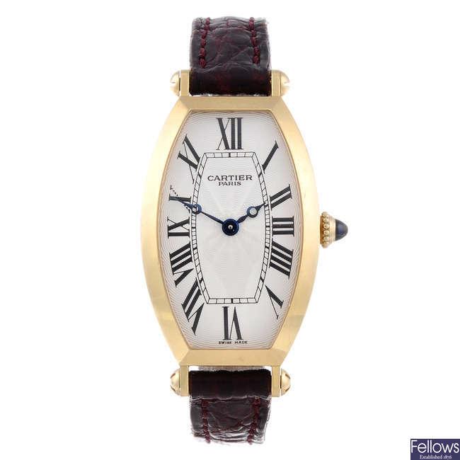 CARTIER - an 18ct yellow gold Tonneau wrist watch.