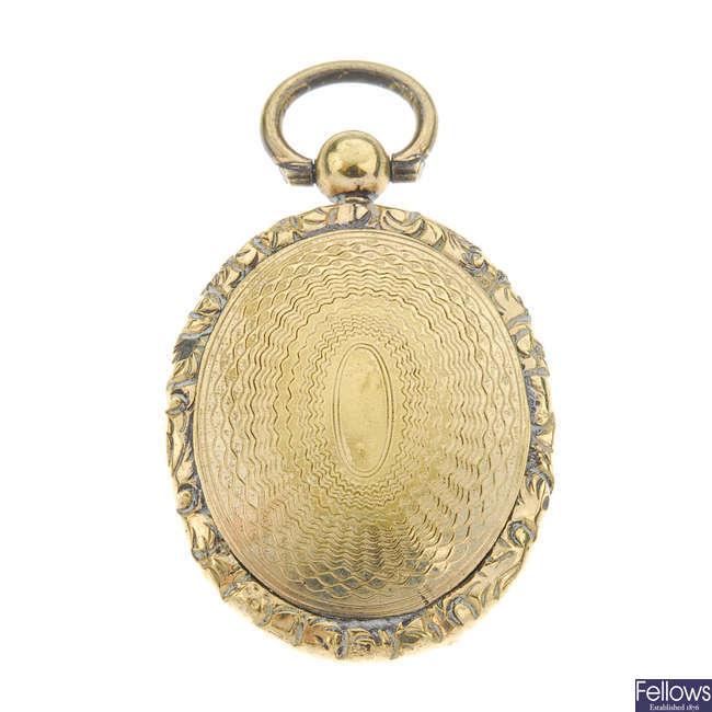 A late 19th century gilt miniature portrait pendant.