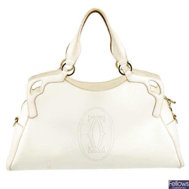 CARTIER - a white leather Marcello De Cartier handbag.