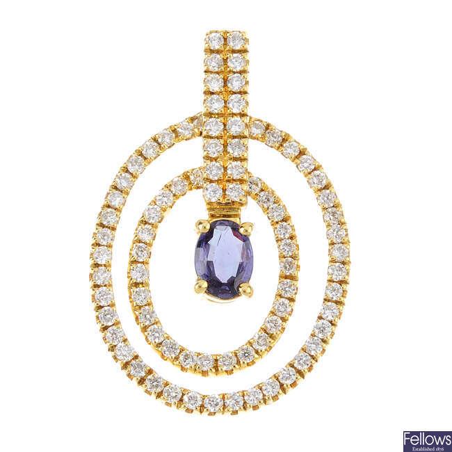 An alexandrite and diamond pendant.
