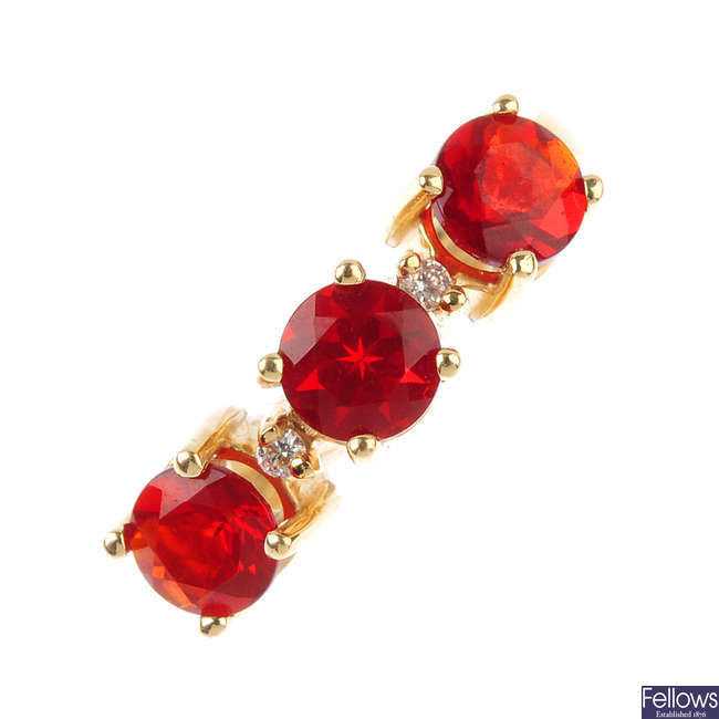 A fire opal and diamond ring.