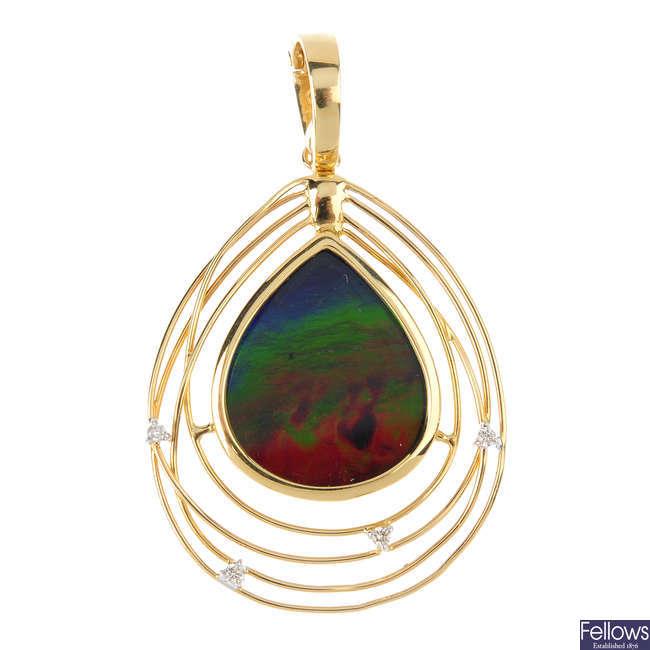 An ammolite doublet and diamond pendant.