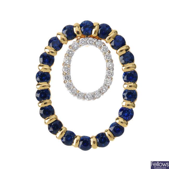 A sapphire and diamond pendant.