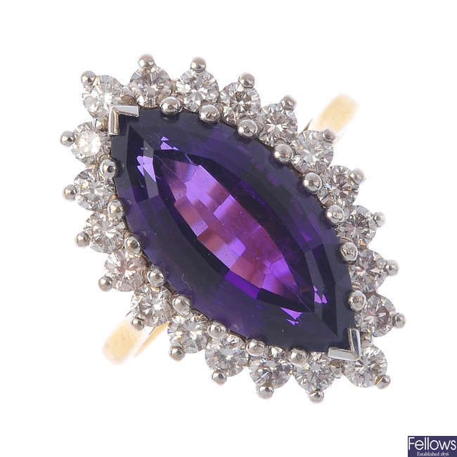 An 18ct gold amethyst and diamond cluster ring.