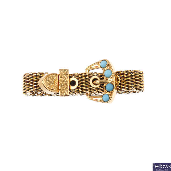 An early 20th century gold turquoise adjustable buckle ring.