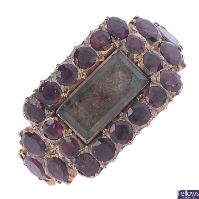 A mid Victorian garnet and hair memorial ring.