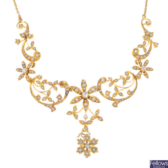 An early 20th century 15ct gold, diamond and split pearl necklace.