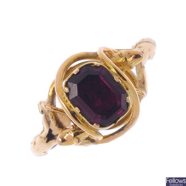 A garnet single-stone ring.