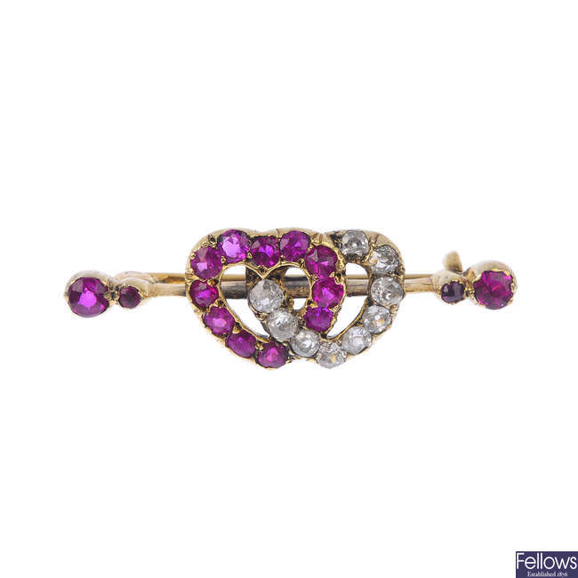 A late Victorian gold synthetic ruby and diamond double heart brooch, circa 1890.