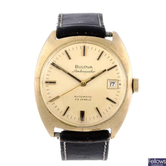 BULOVA - a gentleman's 9ct yellow gold Ambassador wrist watch with two Bulova watches.
