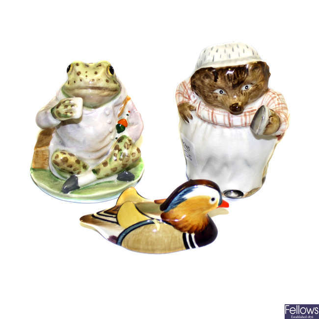 Two Beswick F Warne & Co Ltd Beatrix Potter figures, together with a Beswick Peter Scott Mandarin Duck.