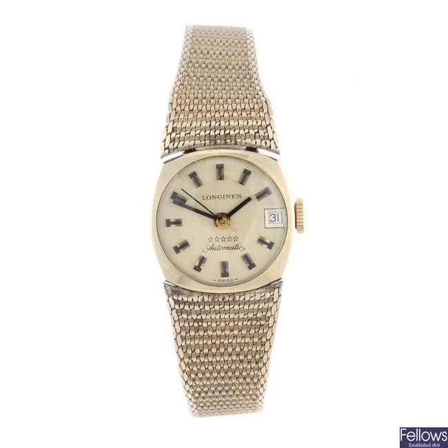 LONGINES - a lady's gold plated bracelet watch.