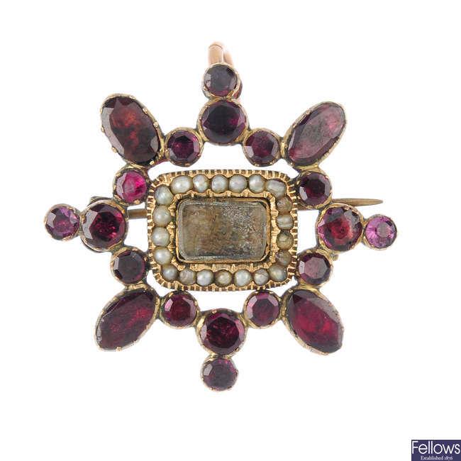A mid Victorian garnet and split pearl memorial brooch.