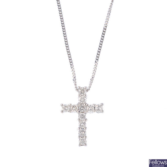 A diamond cross pendant, with 18ct gold chain.