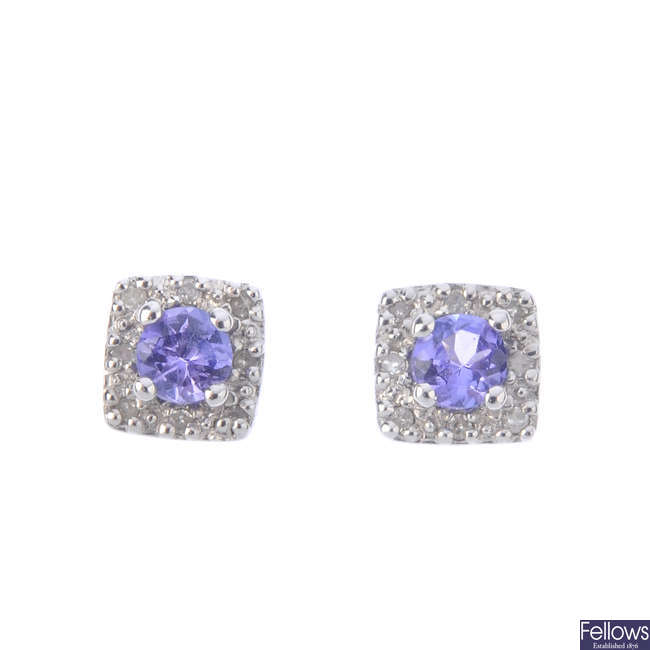 A pair of tanzanite and cluster diamond earrings.