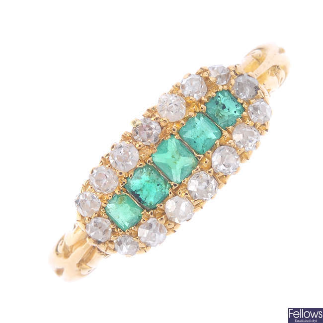 An early 20th century emerald and diamond dress ring.