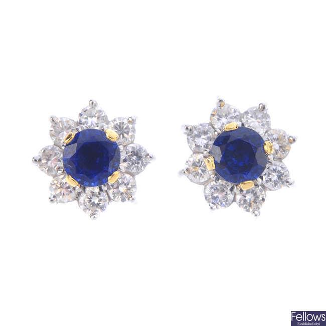 A set of multi-gem stud earrings, with diamond interchangeable jacket.