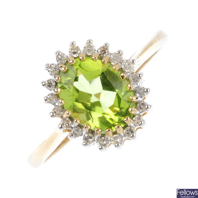 A 9ct gold peridot and diamond cluster ring.