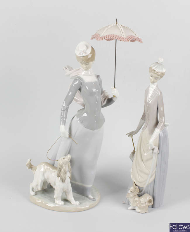 A group of five Lladro figures.