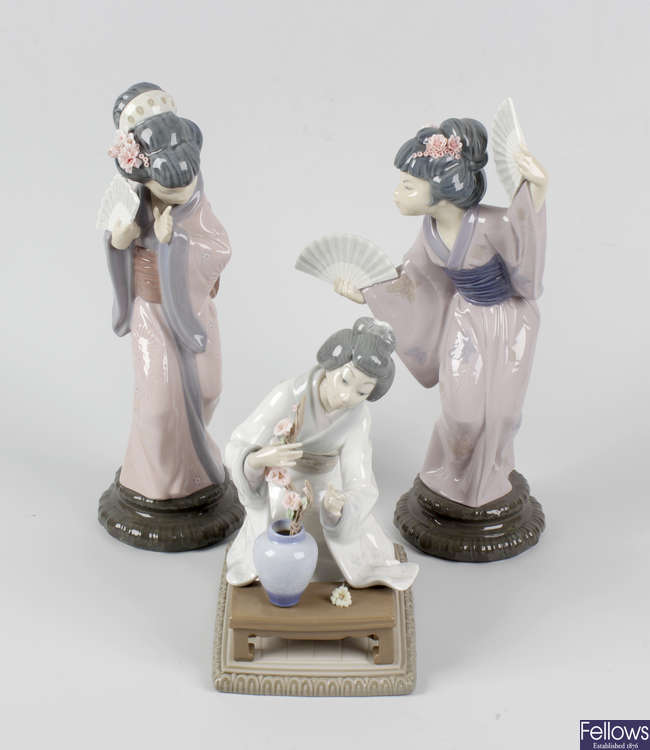 A set of three Lladro Japanese style figures.