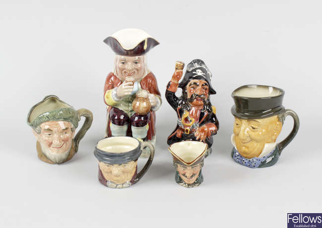 A large collection of assorted Toby jugs