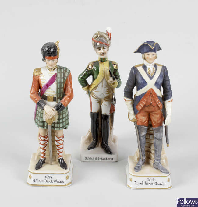 A group of eight Continental porcelain military figures, plus four prints.