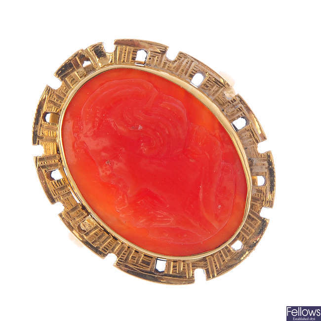 A coral cameo ring.