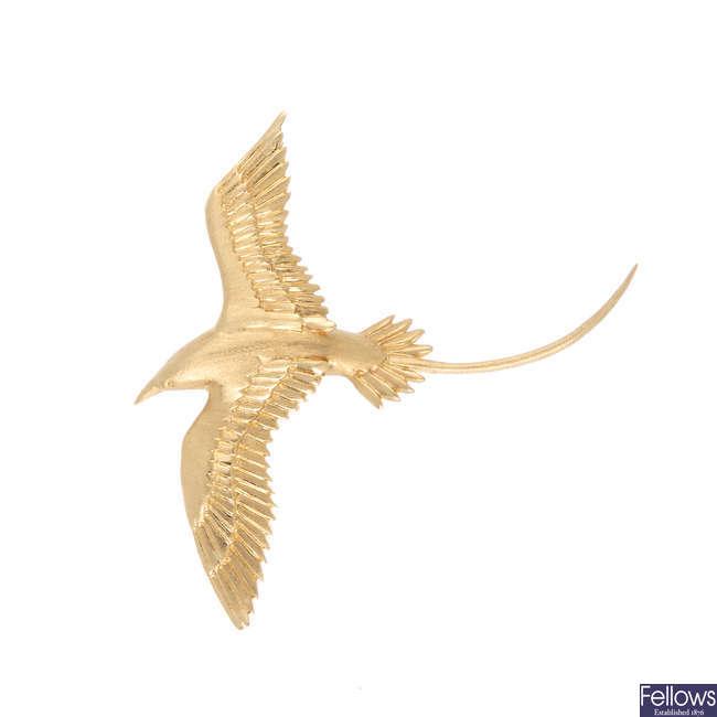 A bird brooch.