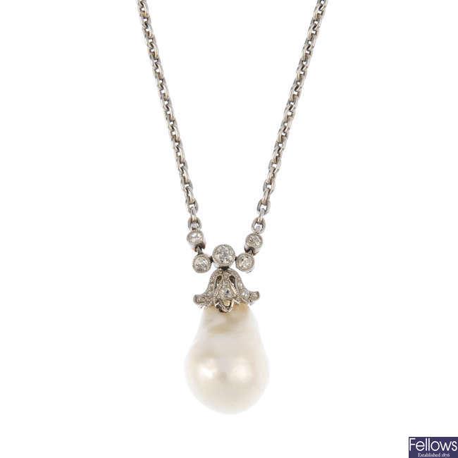 A pearl and diamond pendant.