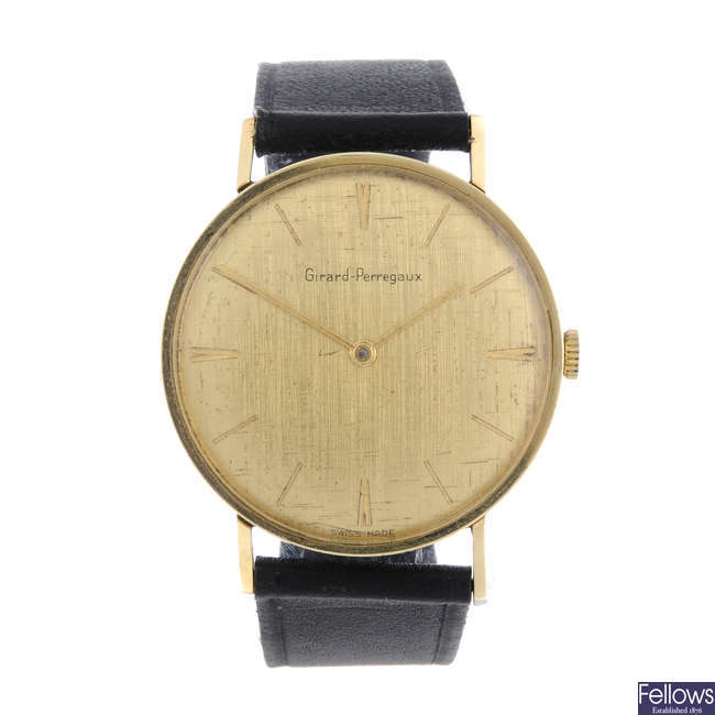 GIRARD PERRAGAUX - a gentleman's gold plated wrist watch with a pendent watch.