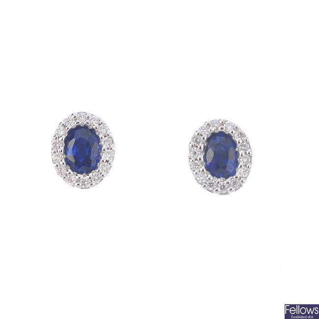 A pair of 18ct gold sapphire and diamond cluster earrings.