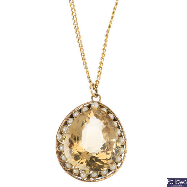 A citrine and seed pearl pendant, with chain.