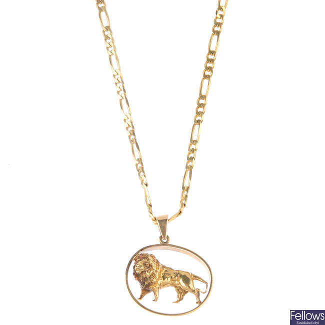 A lion pendant, with 9ct gold chain.