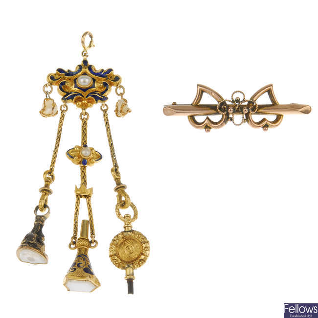 A late 19th century enamel and pearl fob pendant and a late victorian 9ct gold brooch.