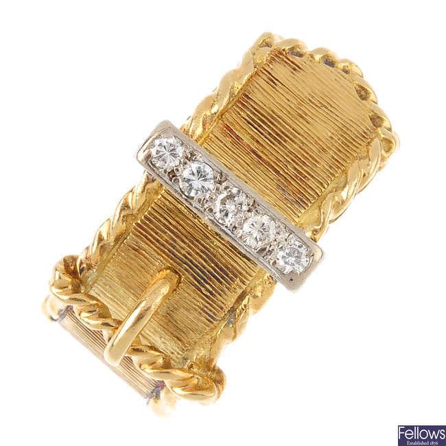 A diamond buckle ring.
