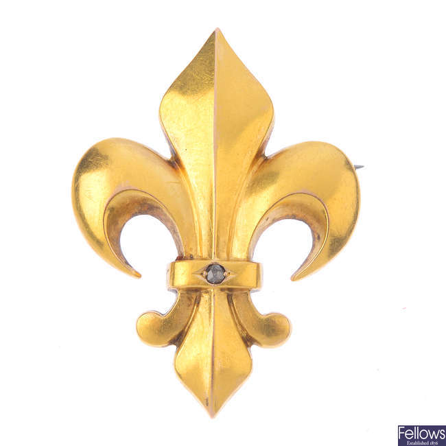 A late Victorian gold fleur-de-lis diamond brooch, circa 1870.