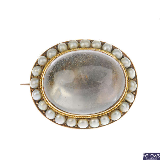 A late Victorian split pearl and later added rock crystal cabochon brooch.
