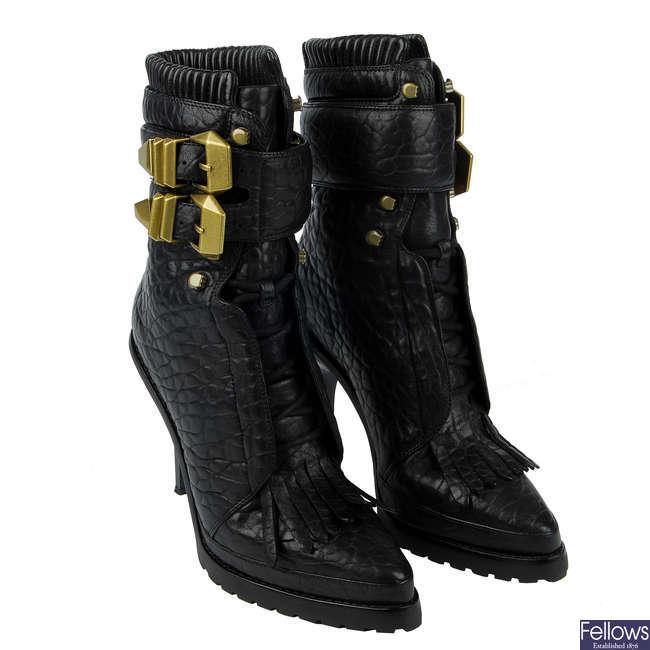 ALEXANDER WANG - a pair of Lara combat boots.