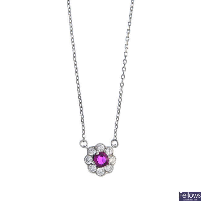 An 18ct gold ruby and diamond floral cluster pendant, on a chain.