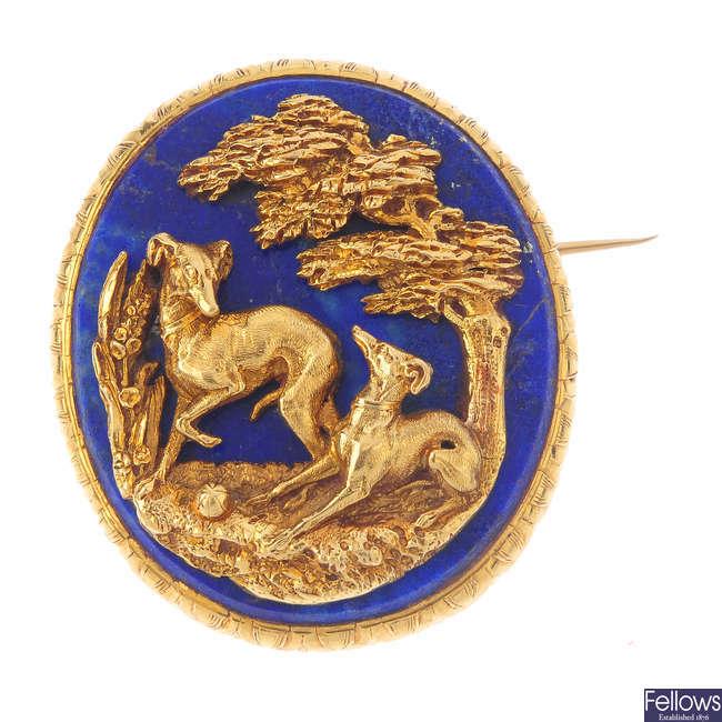 A gold lapis lazuli brooch.