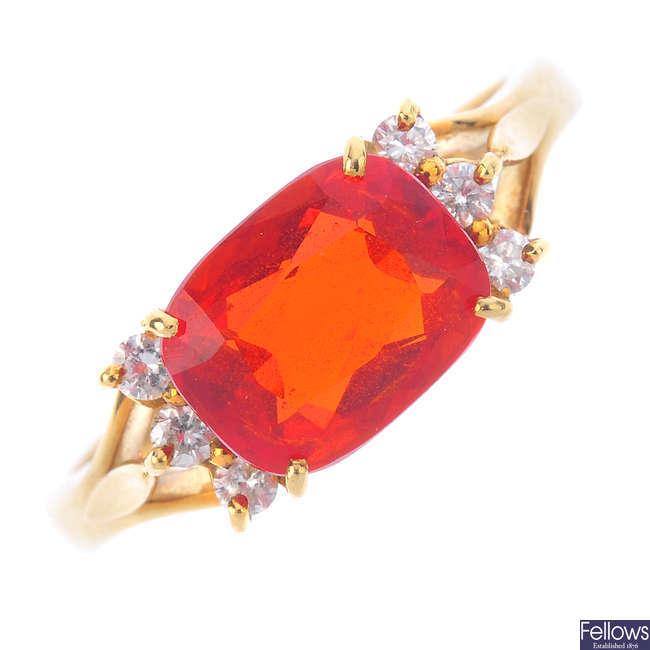 An 18ct gold fire opal and diamond dress ring.