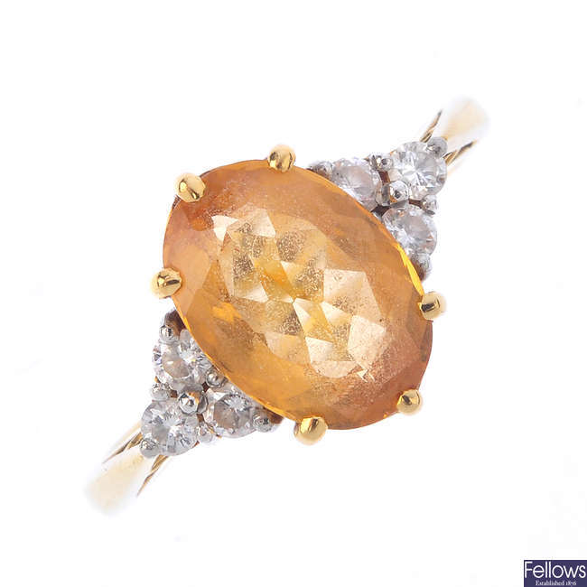 An 18ct gold topaz and diamond dress ring.